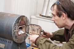 Man  working with  muffle furnace Royalty Free Stock Image