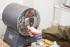 Man is working with  muffle furnace Stock Images