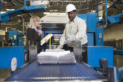 Man Working On Newspaper Production Line Stock Image