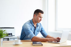 Man working with notebook in the office stock images