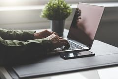 The man is working with a notebook. In the office royalty free stock images