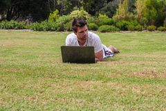 Man working on Notebook outdoors Royalty Free Stock Photo