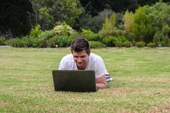 Man working on Notebook outdoors Royalty Free Stock Photography