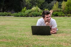 Man working on Notebook outdoors Royalty Free Stock Photos