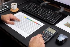 Man Working in Office and Analyzing Some Statistical Calculation. Reports stock photography