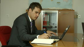 Man working in office on computer stock footage