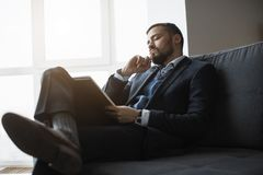 Man Working In Office Doing Notes royalty free stock photo