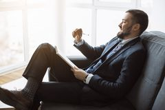 Man Working In Office Doing Notes royalty free stock photography