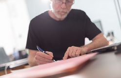 Man working in office, hard light effect Stock Images