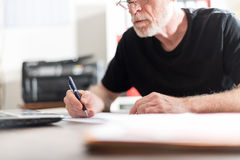 Man working in office, hard light effect Royalty Free Stock Photos