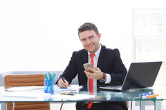 Man working at the office on laptop. Business man working at the office on laptop Royalty Free Stock Images