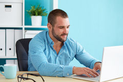 Man working in the office with laptop stock photo