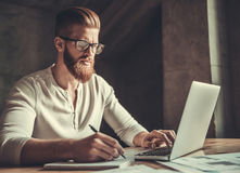 A man while working in an office Royalty Free Stock Images