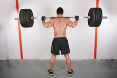 Man working out with a bar Royalty Free Stock Photography
