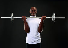 Man working out with barbell Royalty Free Stock Images