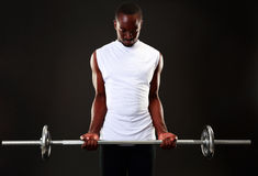 Man working out with barbell Royalty Free Stock Image