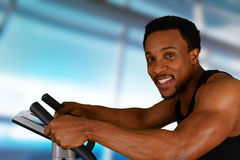 Man Working Out On Bike Stock Photo