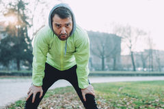 Man working out in the city park. In cold weather Stock Photo