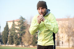 Man working out in the city park. In cold weather Stock Photos