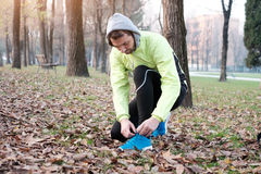 Man working out in the city park. In cold weather Stock Images