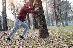 Man working out in the city park. In cold weather Royalty Free Stock Photos
