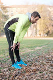 Man working out in the city park in cold weather. Outdoors Stock Image