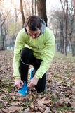 Man working out in the city park in cold weather. Winter Royalty Free Stock Photo