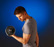 Man working out with dumbbells Stock Photos