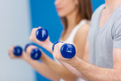Man working out with dumbbells royalty free stock image