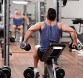 Man working out in front of the mirror Stock Photography