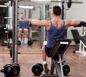 Man working out in front of the mirror Royalty Free Stock Photo