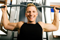 Man working out in gym royalty free stock photography