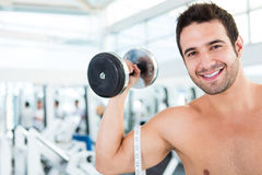 Man working out at the gym Royalty Free Stock Images