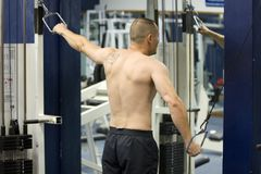 Man working out at gym. A man working out at the gym Stock Photo