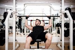 Man working out at gym, chest bench press exercise Stock Image