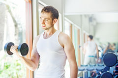 Man working out in gym Stock Images