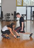 Man working out with his pesonal trainer royalty free stock photo