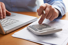 Man Working Out Household Finances Royalty Free Stock Photography