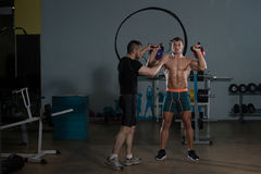 Man Working Out Kettle Bell With Personal Trainer Stock Photos