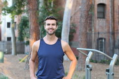 Man working out in the park. Handsome man working out in the park Stock Photos