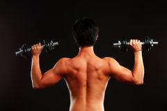 Man working out wirh dumbbells Royalty Free Stock Photography