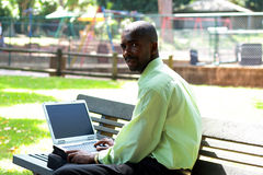 Man working outdoors. An african businessman working outdoors Stock Photography