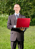 Man working outdoors as a freelancer Royalty Free Stock Image