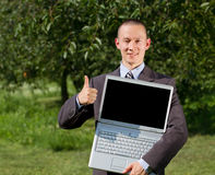 Man working outdoors as a freelancer Royalty Free Stock Photo