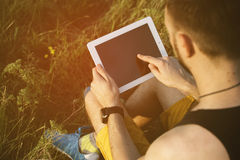Man working outdoors with tablet pad Royalty Free Stock Image