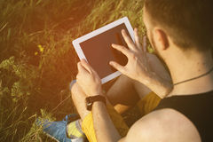 Man working outdoors with tablet pad Stock Photography