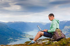Free Man Working Outdoors With Laptop Stock Photos - 71349343