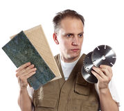 Man in working overalls chooses a detachable disk for the tool Stock Image