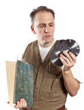 The man in working overalls chooses a detachable disk for the tool on a white background Royalty Free Stock Photography