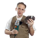 The man in working overalls Stock Images